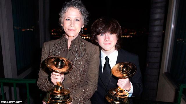 Melissa McBride y Chandler Riggs en los Saturn Awards 2014